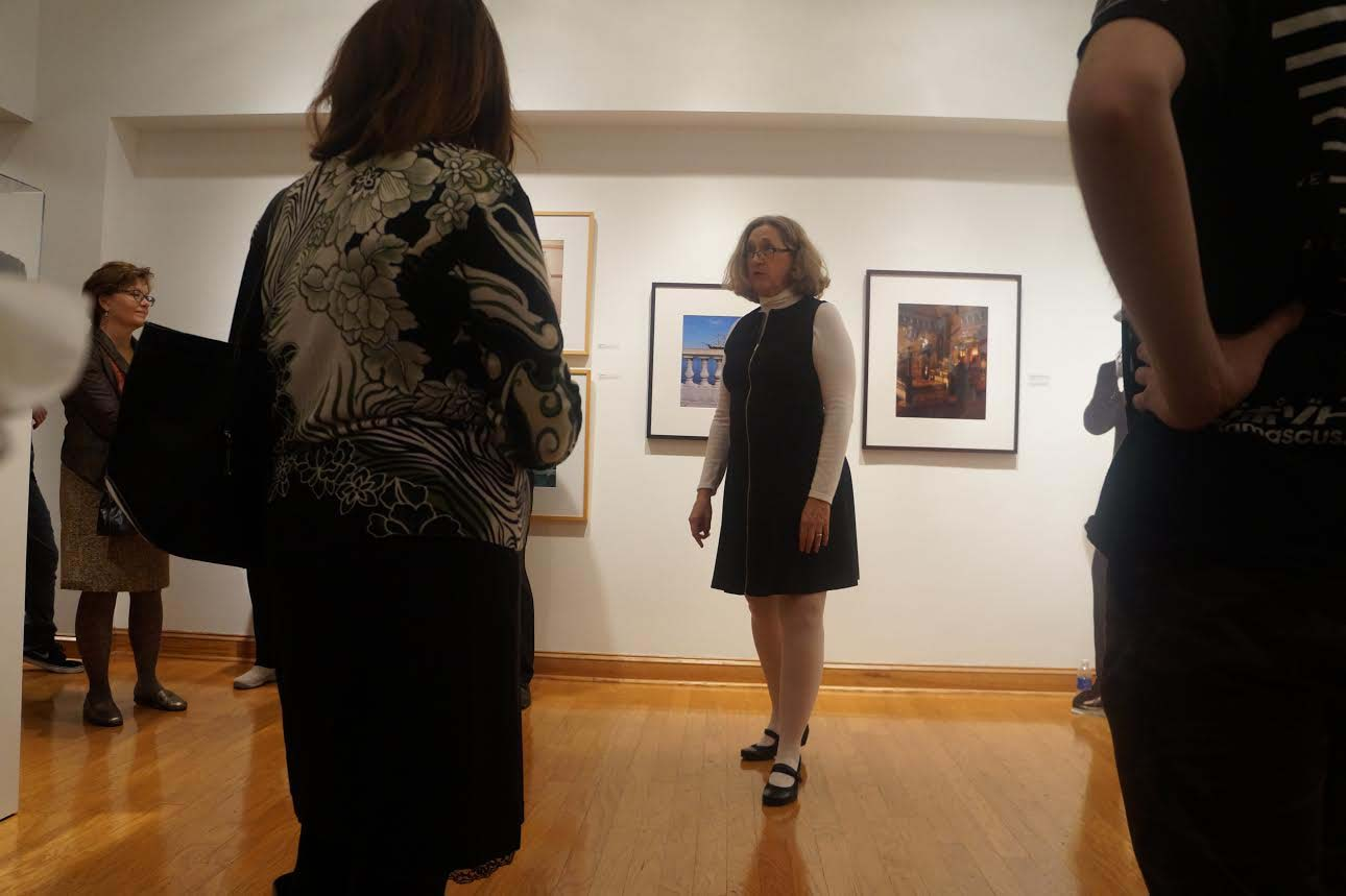 Crosby speaks with visitors at the gallery recepetion. Her current exhibit is