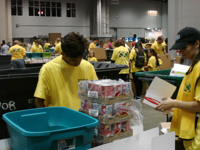 Jena Stansell preparing food kits with other volunteers