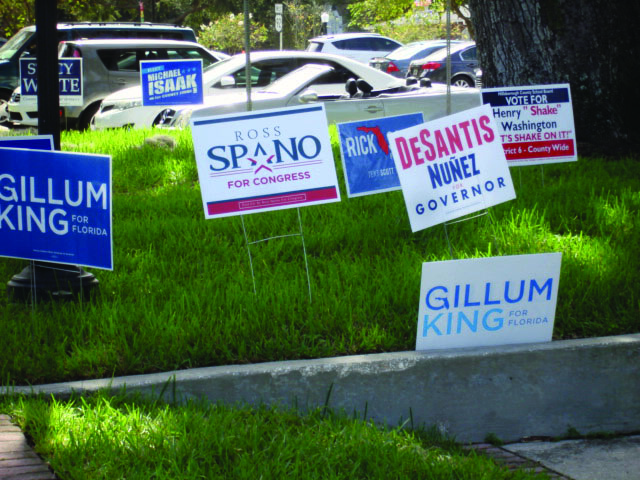 Campaign+signs+outside+polling+location