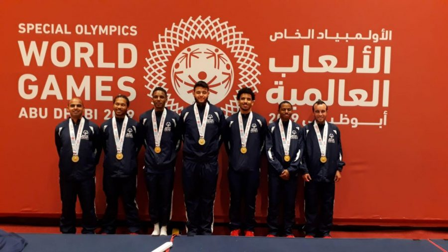 HCC student Albis Amayab (center) brought home the gold medal at the 2019 Special Olympics World Games. The team photo includes (left to rigth) Andrew Smiley, Trevor Powell, Phomar Williams, Albis Amaya, Jamel Winton, Jherran Whittaker and Shaun Ebanks.