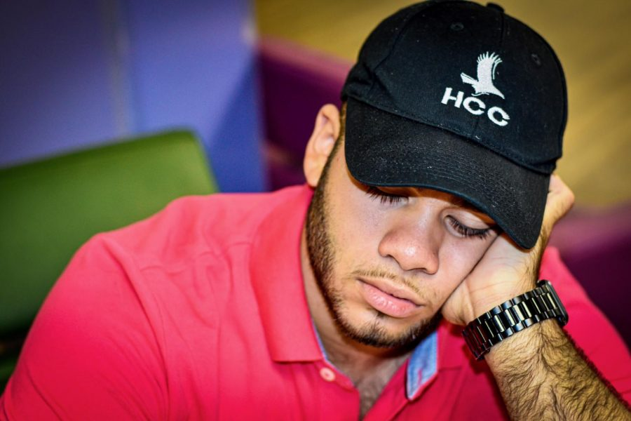 HCC student EliuDaniel Reyes sleeping in the student lounge before his 8 a.m. class.