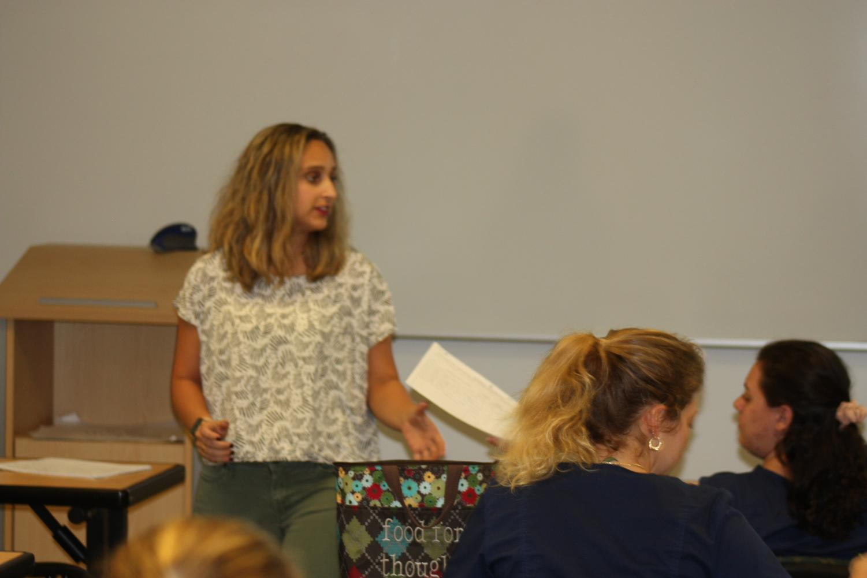 Micaela Alba instructs her class.